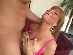 Salacious cougar with big tits fingers her shaved pussy before giving erotic tit job
