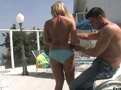 A guy strips off her bikini then fucks her in his beachhouse