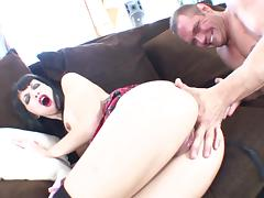 Naughty brunette with big fake tits getting her wet pussy fingered