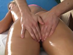 Cute blonde gets jizz on her face after a massage