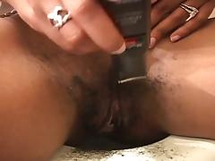 Black slut shaves her pussy for some cock