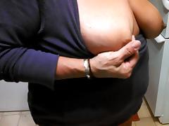 pinching my big dark nipples
