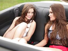 Lesbian babes hook up and get wild in the back of a convertible