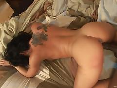 Tattooed brunette gets nailed doggystyle by big black cock in interracial clip