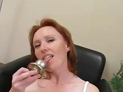 Redhead babe inserts different objects