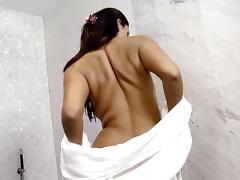 Busty brunette Diana masturbates her pussy in the shower