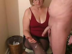 Mrs. Watson gives her neighbour a handjob porn tube video