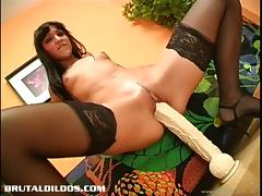 Bubbly brunette with natural tits masturbating with a giant toy