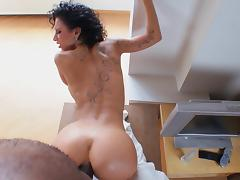Sassy milf with a tattoo gets fucked hardcore by a black guy