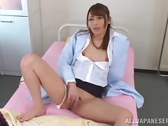 Sexy nurse in uniform fingering her pussy before riding huge dick hardcore