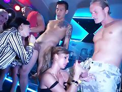 Some captivating chicks blow and get fucked in a club