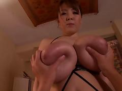 Elegant Japanese milf with big tits gives a tit job in a pov shoot