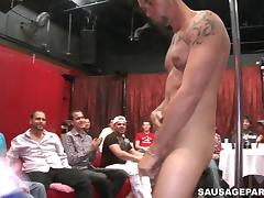 Salacious gay stripper in a bar lets the clients suck his wang tube porn video