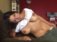 She plays with her big, natural tits while slipping off her pants