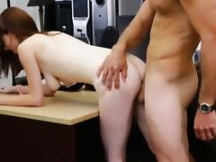Busty redhead babe in glasses fucked at the pawnshop