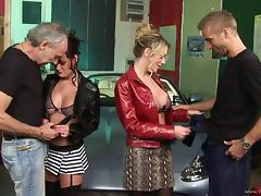 Sexy dame in miniskirt showcasing her smashed juicy pussy in group sex
