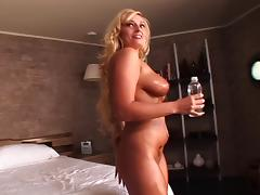 An oiled up MILF gets plowed doggystyle and cums her brains out