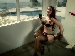 Brunette bombshell Sophia Santi wearing fishnets fingers her cute pussy