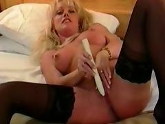 British slut plays with a toy in black hold-ups