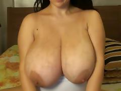 Big breasts spread wide on girl