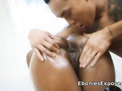 Busty black gags a hard Asian guy