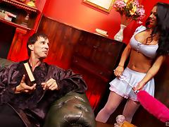 Tattooed brunette cougar in a miniskirt and fishnet stockings getting throbbed hardcore