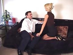 This busty, blonde mistress abuses her man and smothers him
