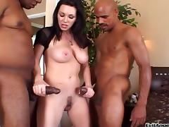 Alluring brunette cougar with big tits takes on two big black cocks