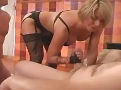 Busty blonde domina plays with a stiff pecker