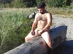 Massive gay hunk jerks off in the open air