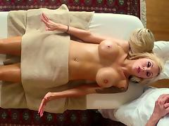 Tattooed blonde babe getting her faked tits squeezed on a massage table