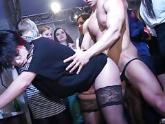 Palpitating cowgirl gives a big black cock a blowjob at a hot orgy in the club