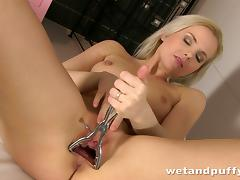 Affectionate blonde solo model with natural tits enjoying having insertions in her pussy