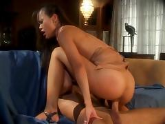 Young Asian temptress eats pussy while fucked doggystyle by big cock on a couch