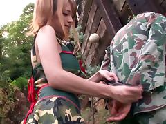A sexy soldier gives a lucky guy head out in the forest tube porn video