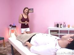 Elegant Japanese pornstar delivers a hot massage with a happy ending