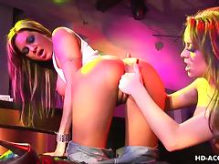 Lesbo fun with a dildo sliding in the ass