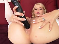 Fascinating blonde in nylon stockings  pounds her ass with toys before getting hammered