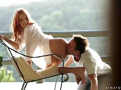 Angelic redhead delivers a stunning blowjob after getting spooked in an erotic scene