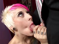 Tattooed punk with big boobs sucking a stranger's huge cock