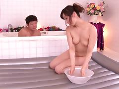 A Japanese woman gives her man a massage and some pussy