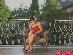 Nikki Rider sits in a chair outside and works her pussy until she cums