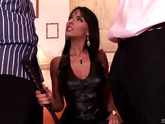 Slut in leather services two cocks and does a double penetration
