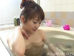 He feasts on her wet Japanese pussy in the bathtub