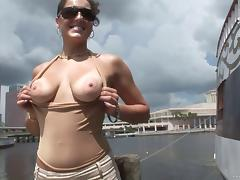 She flashes her natural tits then gets naked and rubs her pussy