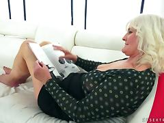 An older woman seduces a younger chick for a lesbian hook up tube porn video