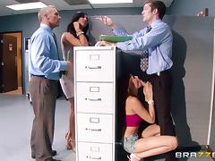 He doesn't seem to mind being caught by the boss, shagging in the office tube porn video