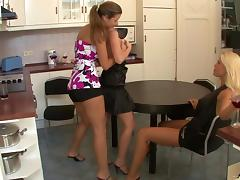 Lesbians in miniskirts enjoys licking and fingering in the kitchen
