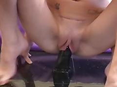 Amateur chick with small tits plays with dildos