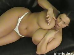 Chubby pigtailed brunette Aneta Buena shows her huge natural jugs